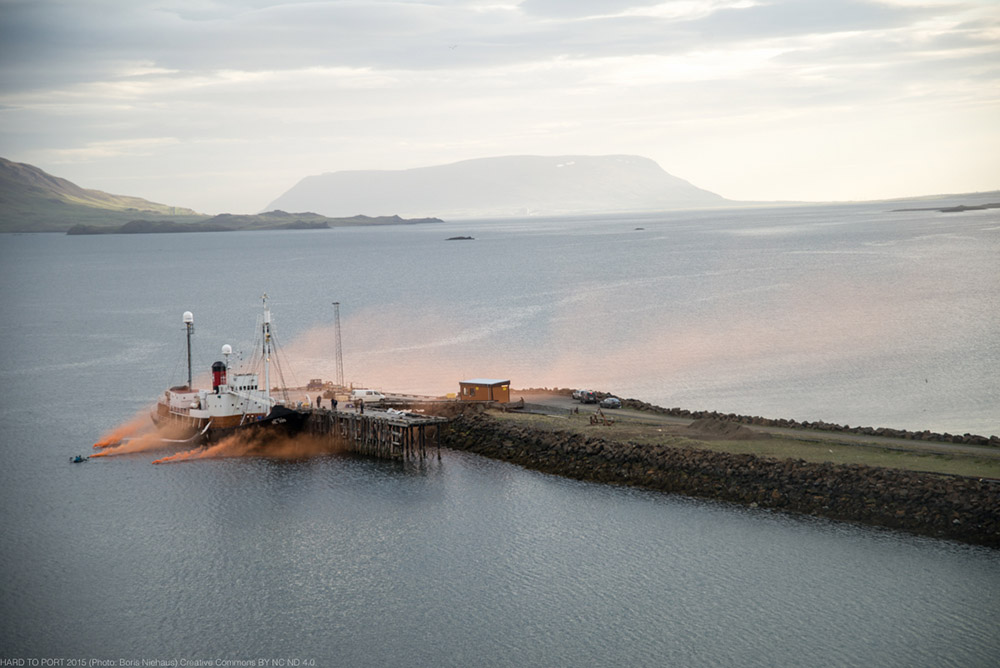 "Port of Hvaljördur, Iceland 30th of June 2015. First whale of the season hunted by the islandic whaler-industry. Activists of the anti-whaling-ngo ""HARD TO PORT"" tried to raise attention by lighting smoke-signals and to climb the dead whale. The fin whale is officially an endangered animal."