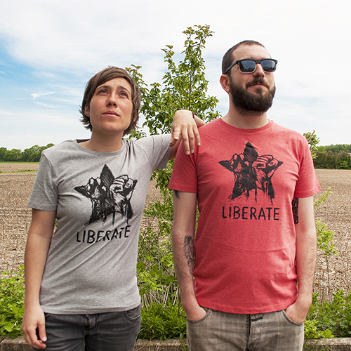 Liberate T-Shirt, two persons are wearing tees in grey and mid heather red